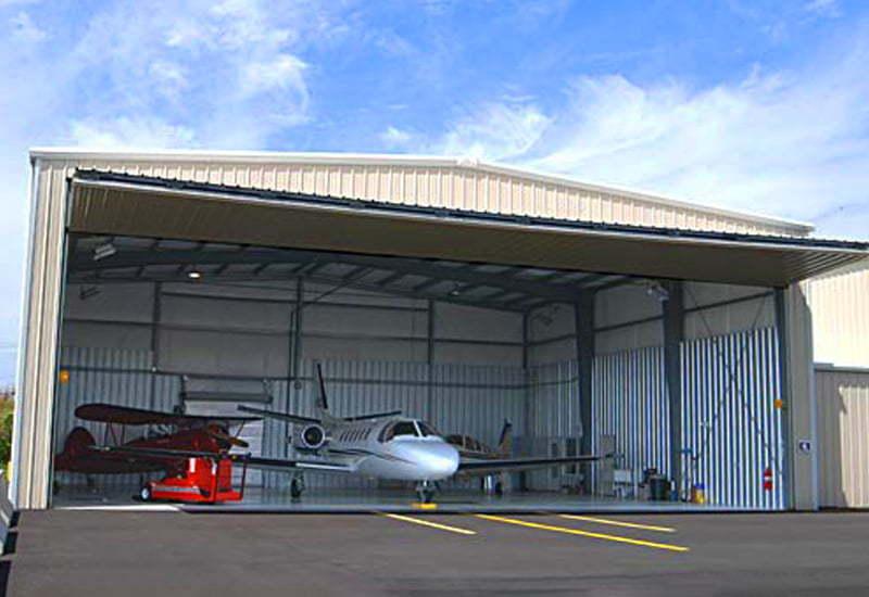 Exterior image of an open prefab steel airplane hangar