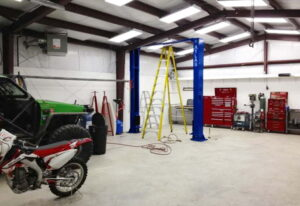 Interior of a pre engineered steel workshop and garage that houses a motorcycle