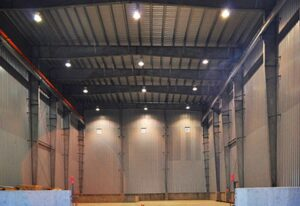 Interior of a prefabricated industrial steel buildings with rigid framing and roof purlins
