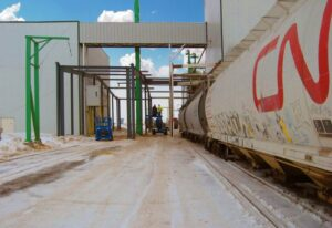 Prefabricated industrial steel buildings with overhead passage
