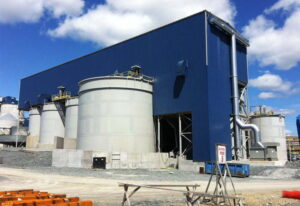 Prefabricated industrial steel buildings facility with exhaust openings