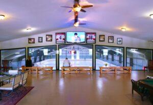 Interior image of a prefab steel hockey arena viewing from upper floor steel mezzanine