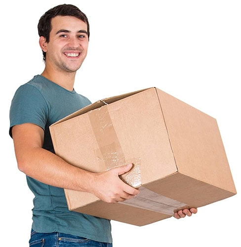 A man moving a box to go put it into a steel storage unit