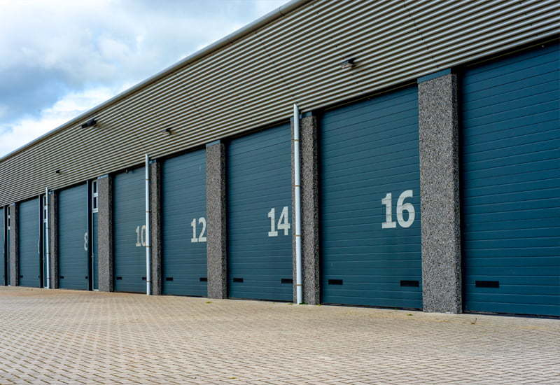 Long view of blue colored steel storage units